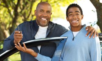 Father giving teenager car keys