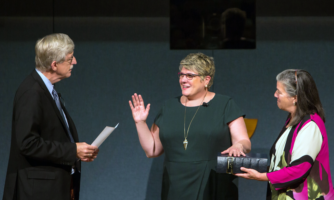 National Institutes of Health Director Francis S. Collins, M.D., Ph.D., swears in Patricia Flatley Brennan, R.N., Ph.D., as the 19th director of NLM.